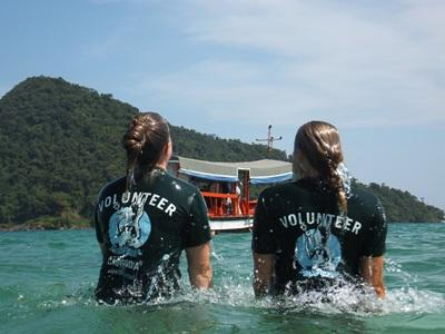 Two volunteers swimming in Cambodia
