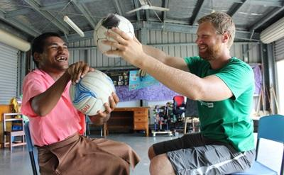 A volunteer runs a physiotherapy session in Samoa