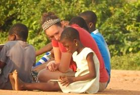 A volunteer interacts with a child on a Care and Community Project placement in Ghana