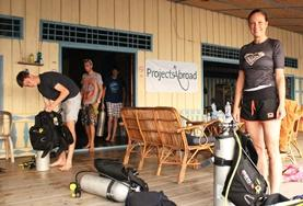 Volunteers interact with their diving gear on a Marine Conservation Placement in Cambodia