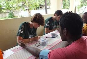 A Public Health volunteer in Sri Lanka measures a local man's blood pressure, gaining important medical experience during her internship.
