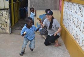 A Social Work volunteer plays with children at her placement in Ghana