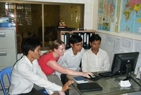 A volunteer demonstrates to her colleagues on a Journalism Project in Cambodia