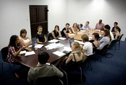 A professional Lawyer gives a workshop to a group of Law volunteers, explaining issues of human rights abuses in South Africa.