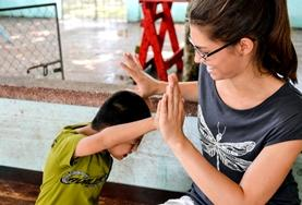 An Occupational Therapy volunteer in Nepal works with a patient