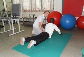 A volunteer works with a patient on a Physiotherapy Project placement in Ghana