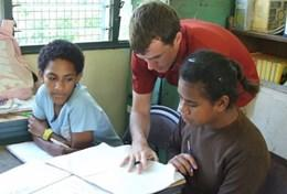 A Speech Therapy volunteer works with children at his placement in Fiji