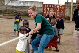 A volunteer plays with children on a Special Educational Needs Teacher Project placement in Ghana