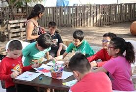 Children partaking in arts and crafts activities at a care placement in argentina