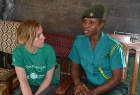 A volunteer listen intently to an official on a Human Rights Project placement in Ghana