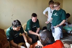 Medicine volunteers inspect patients at their placement in Kenya