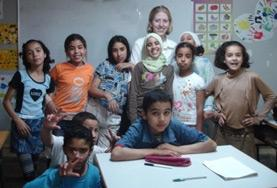 A Teaching volunteer spends time with the students in her class at a local school in Morocco.
