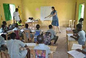 Two students prepare for an IT lesson at one of the schools where we run our volunteer Teach IT project in Ghana.