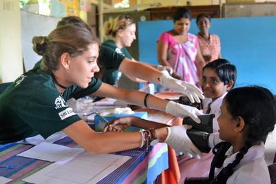 Public Health volunteer doing basic checks during a medical outreach